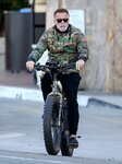 arnold-schwarzenegger-on-an-electric-bike-felt-outfitter.jpg