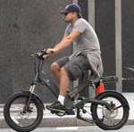 leonardo-dicaprio-riding-an-electric-bicycle-a2b-metro.png